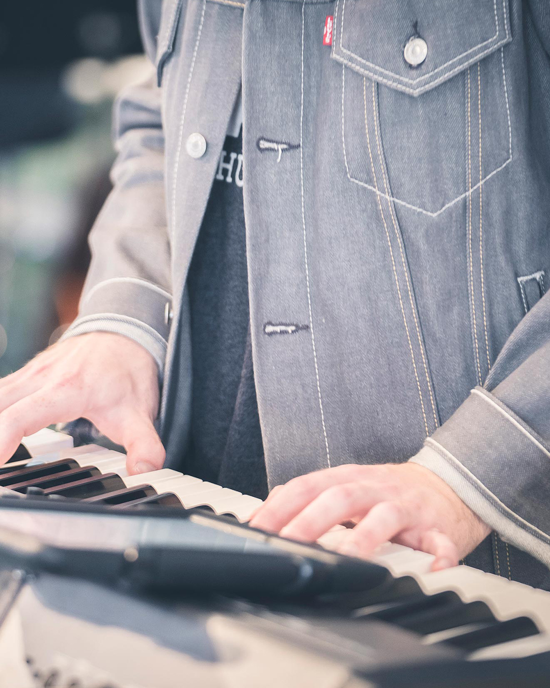 Keyboardist playing during a weekend worship service at Pearce Church in Rochester, NY